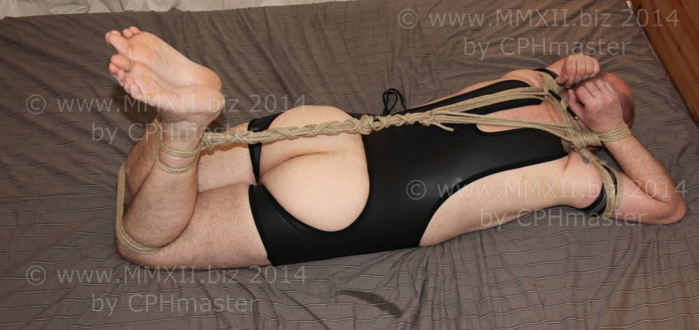 Hog-tied on bed 4